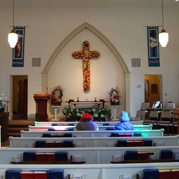 Photo of Sanctuary with the Cross decorated for Easter